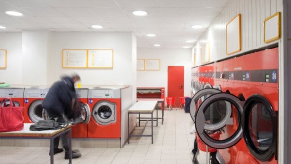 Man in launderette